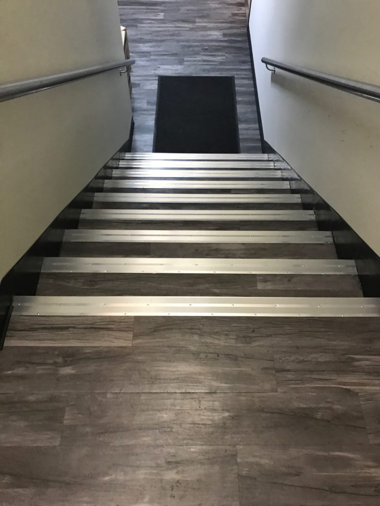 Laminate Staircase With Metal Stairnose In Commercial